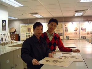 Feng Changlin, left, studying plant specimens at the Hong Kong Herbarium, together with the Director of Herbarium to the right.