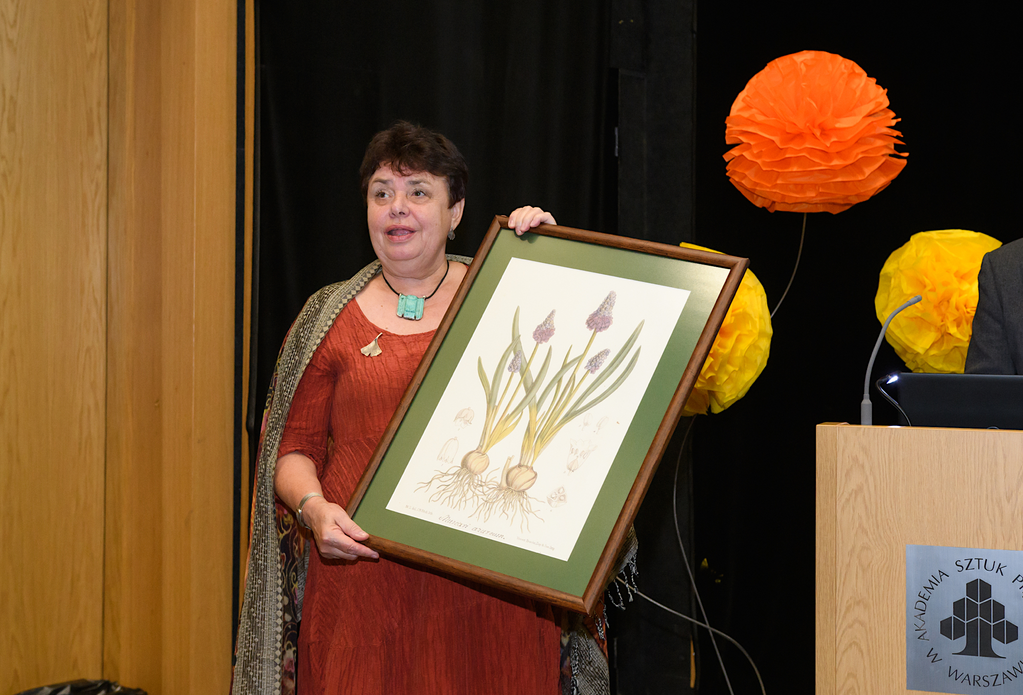 Hanna receving a gift at the 9th Education Congress held in Warsaw