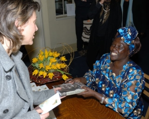 Professor Wangari Maathai signing copies of her autobiography