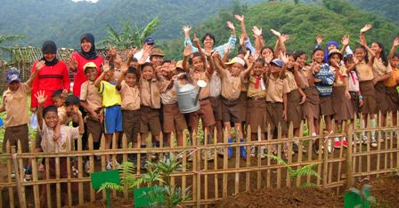 schoolchildren in Indonesia after treeplanting